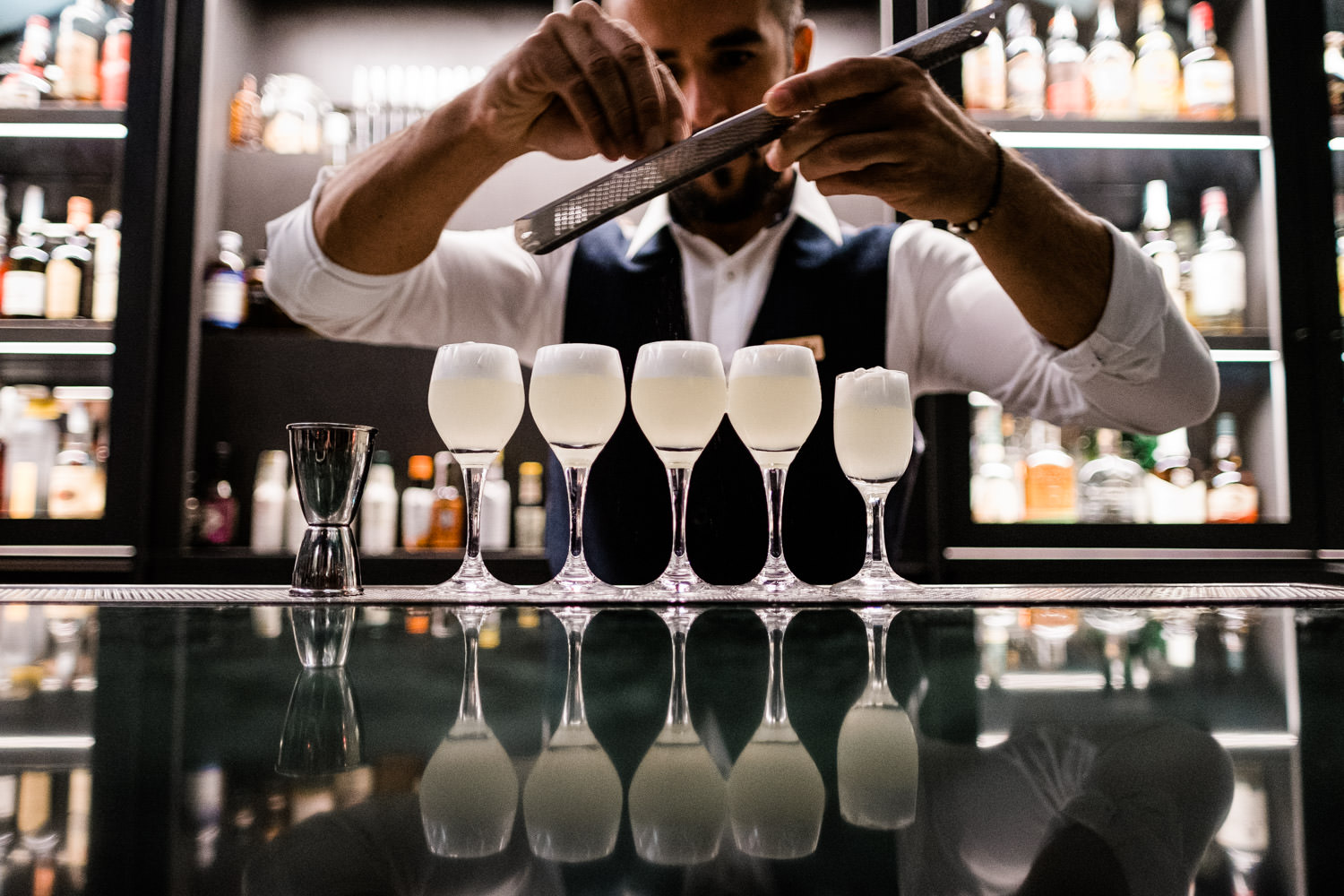 A photograph of barman preparing cocktails at a corporate event in Barcelona, Spain.