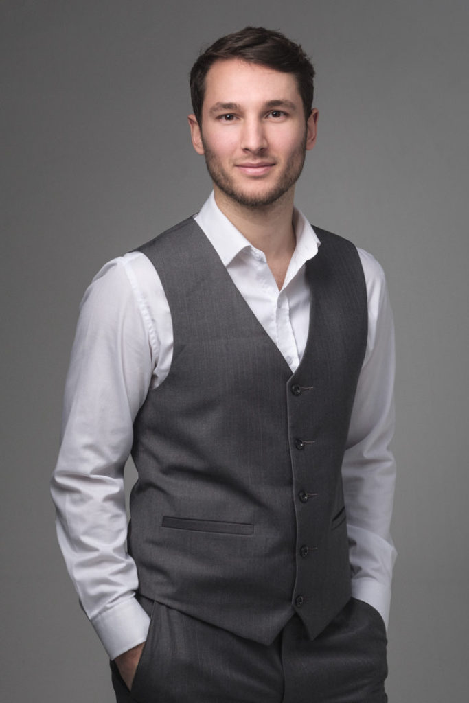 portrait photography pose of a man in a waistcoat