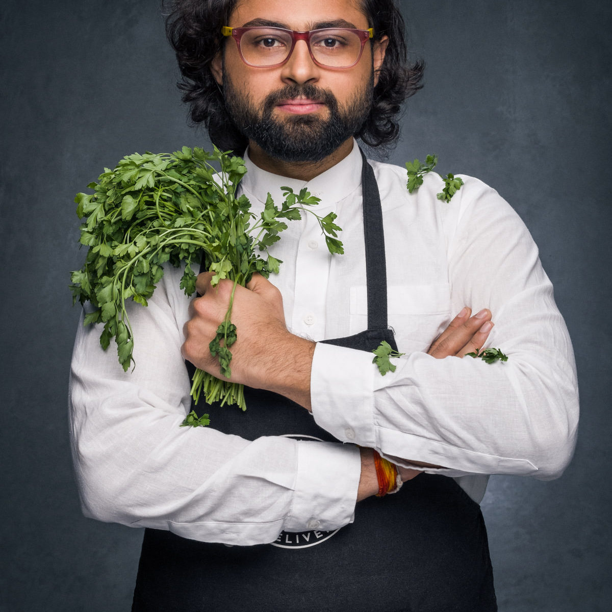 Personal Branding Photography of an Indian chef holding herbs