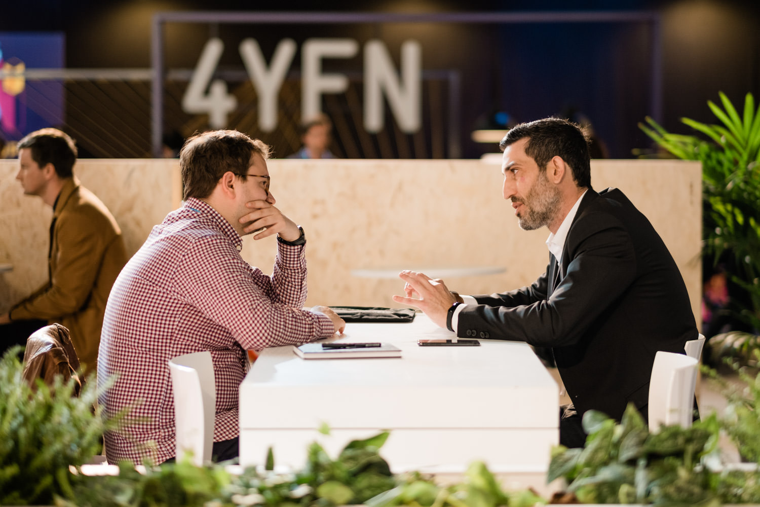 A photograph of two men talking during the 4YFN event, during the Mobile World Congress in Barcelona, Spain