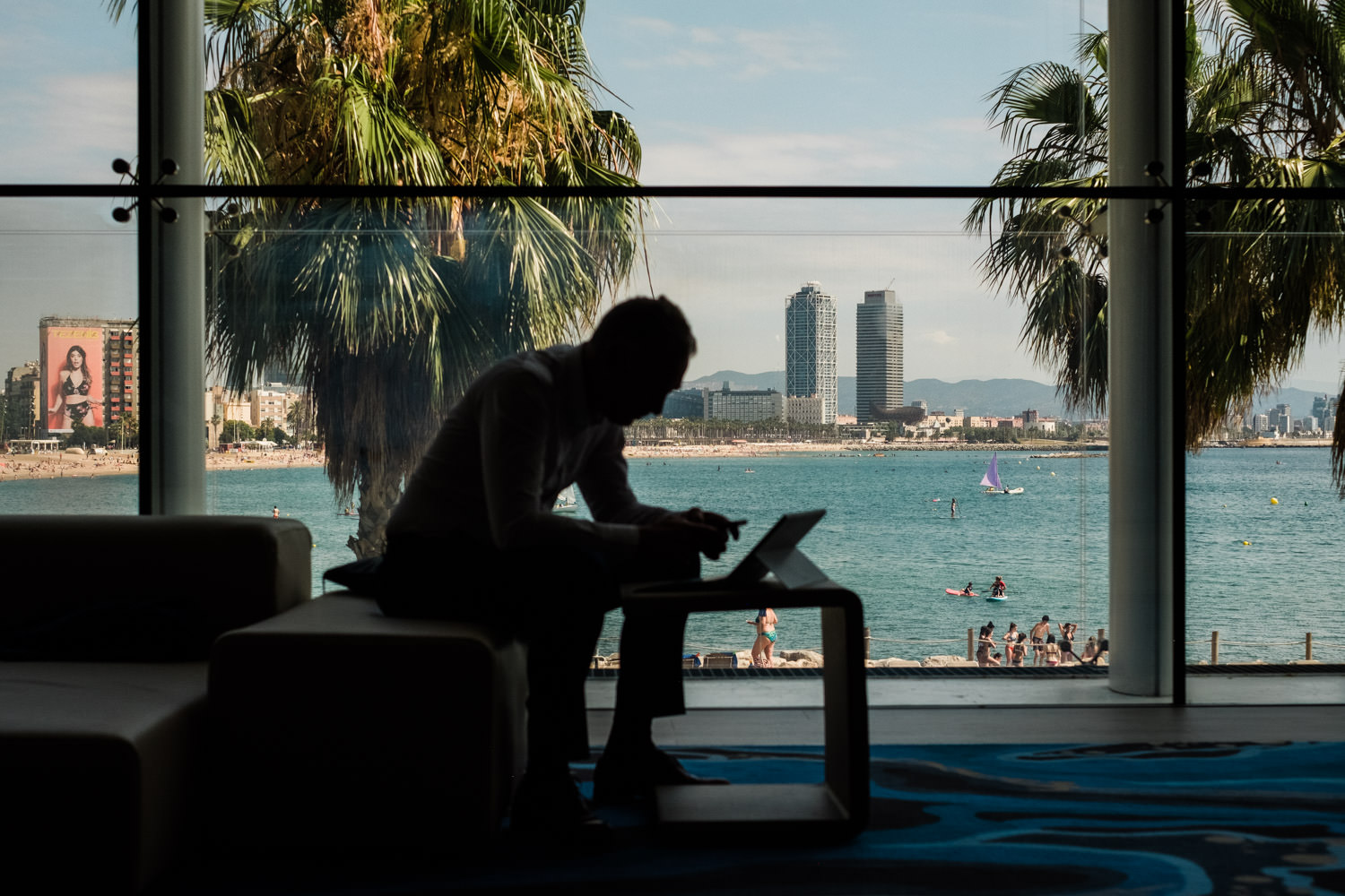 A photograph of a business man, working on a computer, at the W Hotel, during the KPMG conference event in Barcelona, Spain.