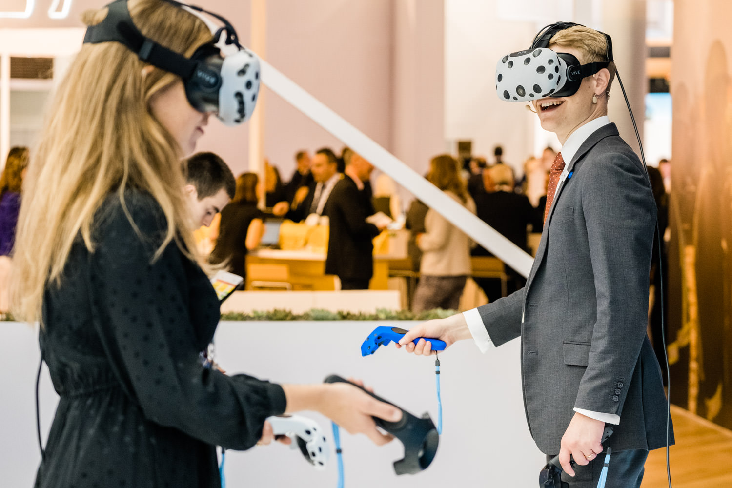 A photograph of 2 professionals from SNC-Lavalin, wearing virtual reality headsets, during the GASTECH conference in Barcelona, Spain.