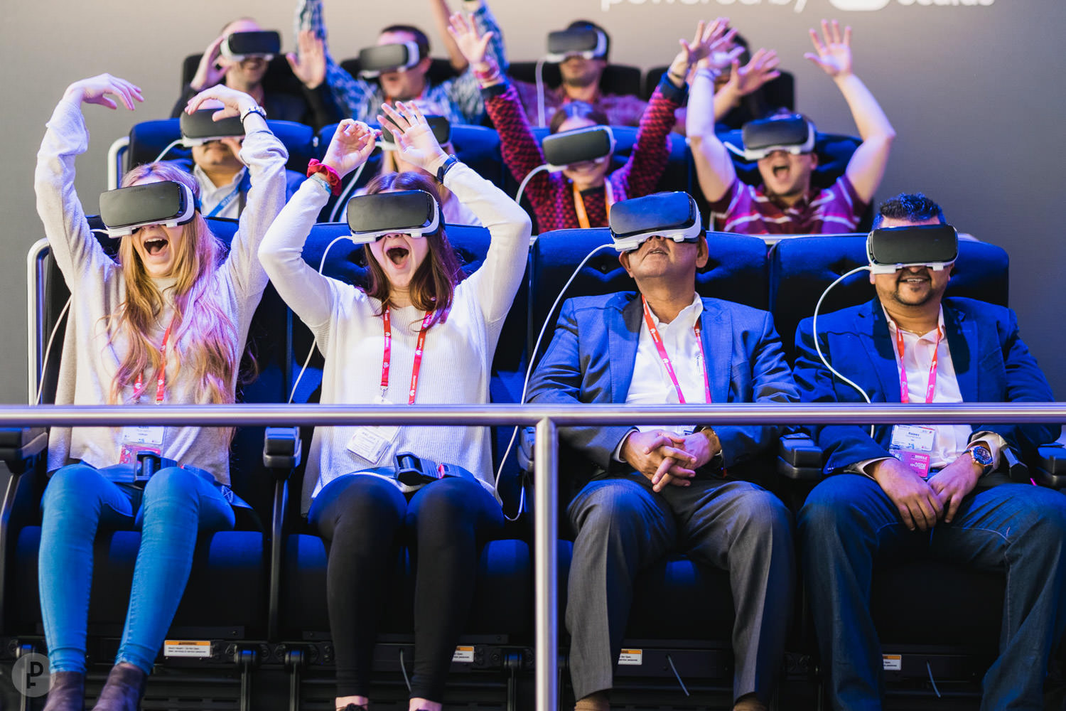A photograph from the Mobile World Conference event in Barcelona (Spain), of people having fun on a virtual reality machine.