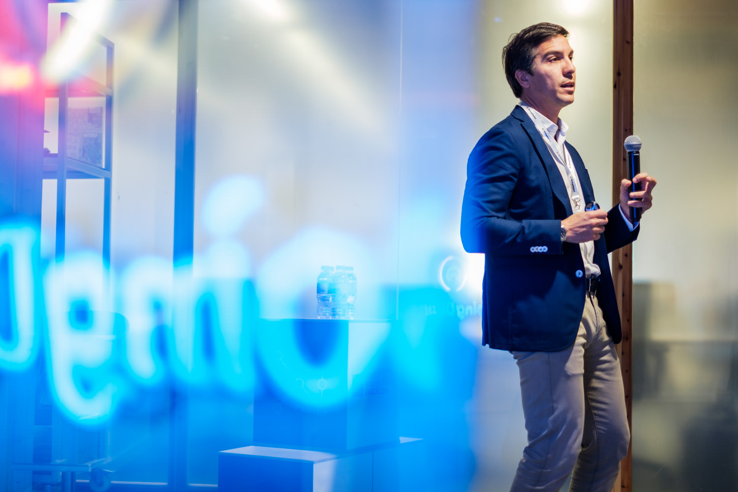 A photograph of Pedro Mateos, Customer Experience & Digital transformation director of Volkswagen, talking on stage during the Going Digital event at the Mobile World Capital in Barcelona, Spain.