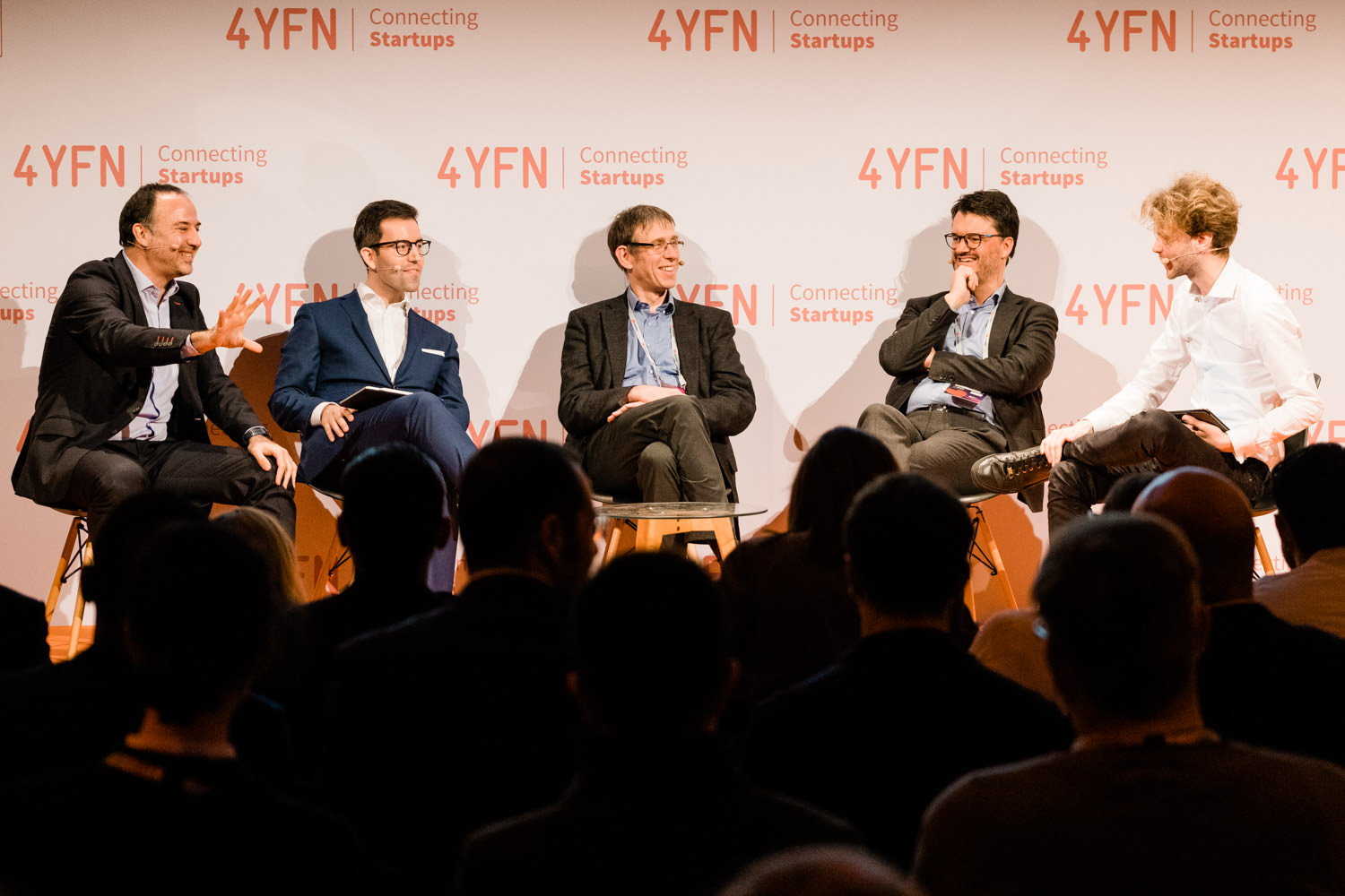 A photograph of Carles Puente, Josemaria Sota, Martin Dietz and Oscar Sala talking at the Agora stage, during the 4YFN event in Barcelona, Spain.