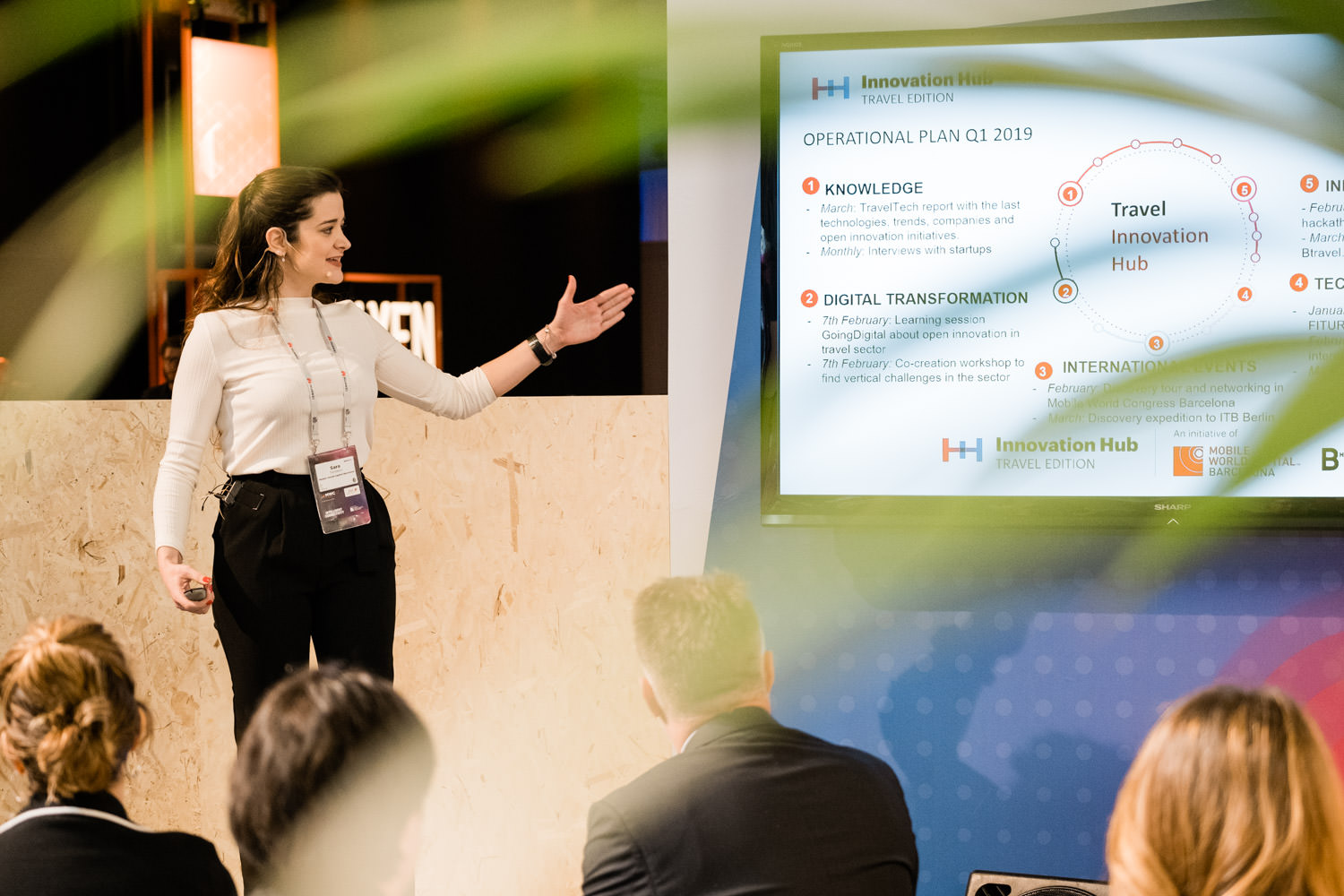 A photograph of a young professional lady giving a presentation at the Mobile World Capital stage, during the 4YFN conference in Barcelona