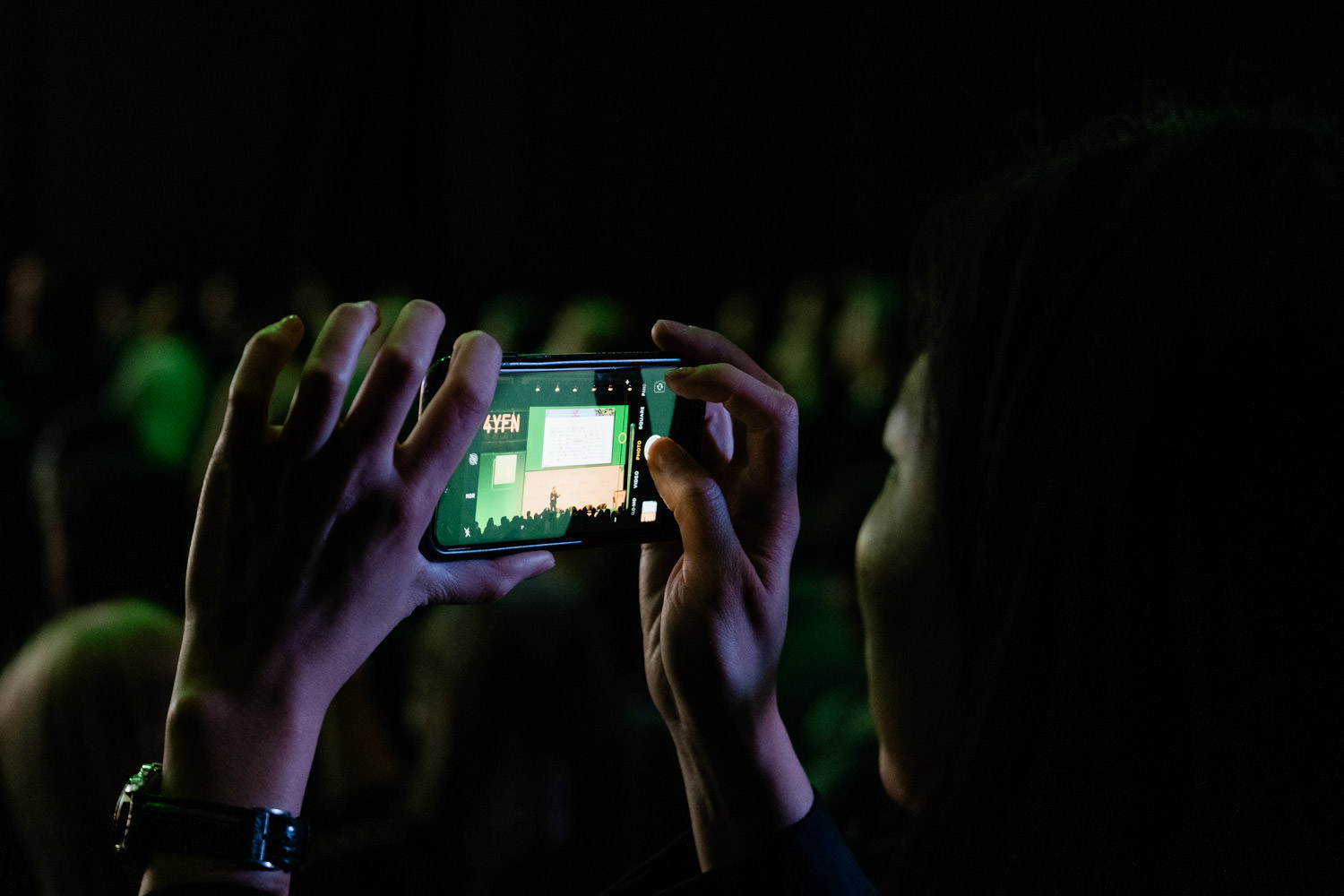 A close up photograph of an audience member taking a photo of the stage, during the 4YFN event in Barcelona, Spain