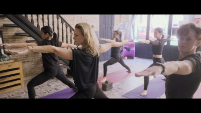 Students practice yoga in Barcelona Yoga school The House Of Yoga