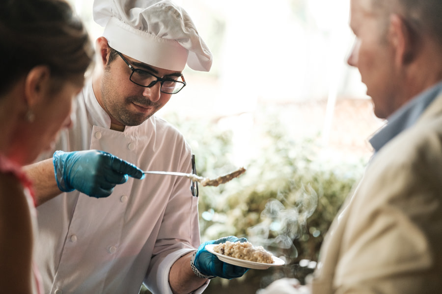A photograph of a chef serving food at the Accor Luxury Hotel event at the Fairmont Rey Carlos hotel in Barcelona.