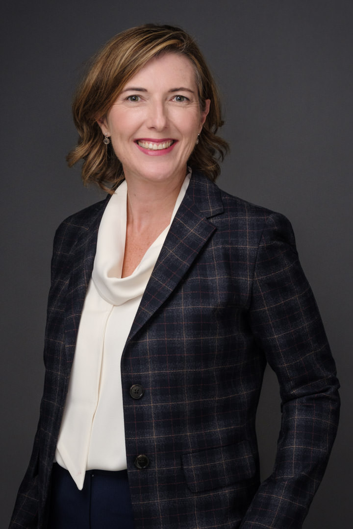 Professional corporate portrait of lady in suit