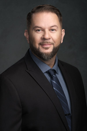 A traditional formal corporate headshot